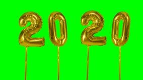 Globo del oro de la celebración del aniversario del cumpleaños de la Feliz Año Nuevo del número 2020 que flota en fondo de pantal metrajes