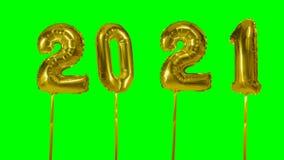 Globo del oro de la celebración del aniversario del cumpleaños de la Feliz Año Nuevo del número 2021 que flota en fondo de pantal almacen de metraje de vídeo