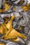 Globo del oro y de la plata desinflado Fotografía de archivo libre de regalías