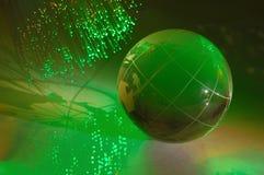 Globo della terra contro fibra Fotografie Stock Libere da Diritti