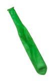 Globo desinflado verde sobre blanco Imagenes de archivo