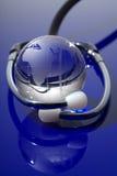 Globo di vetro con lo stetoscopio Immagine Stock