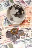 Globo di vetro su valuta indiana Fotografia Stock Libera da Diritti