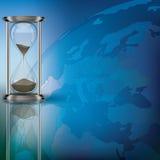 Globo e hourglass no azul ilustração do vetor