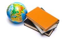 Globo e libri Fotografia Stock