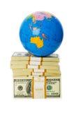 Globo e pilha de dólares Imagens de Stock
