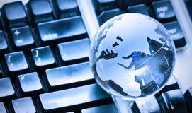 Globo en el teclado Foto de archivo libre de regalías
