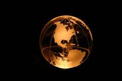 Globo en luz ámbar Foto de archivo libre de regalías