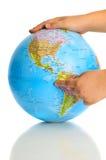 Globo en manos Imágenes de archivo libres de regalías