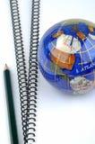 Globo, lápiz y libros Fotografía de archivo