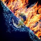 Globo no incêndio e na água Imagens de Stock