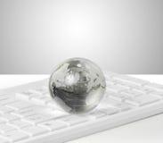 Globo no teclado fotografia de stock royalty free