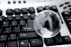 Globo no teclado imagem de stock