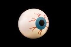 Globo ocular de borracha do brinquedo isolado sobre o preto Imagens de Stock Royalty Free
