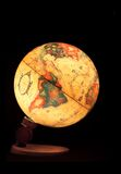 Globo pequeno em um fundo preto Fotografia de Stock Royalty Free