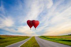 Globo rojo hermoso en la forma de un corazón Fotografía de archivo libre de regalías