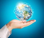 Globo, terra na mão humana Imagem de Stock Royalty Free