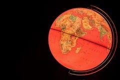 Globo terrestre en fondo negro Imagen de archivo