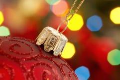 Globo y luces de la Navidad rojos Foto de archivo