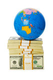 Globo y pila de dólares Imagenes de archivo