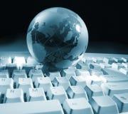 Globo y teclado Foto de archivo libre de regalías