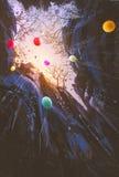 Globos coloreados que flotan en el cielo Fotografía de archivo