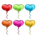 Globos coloridos determinados en la forma de los corazones aislados en b blanco Foto de archivo libre de regalías