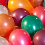 Globos coloridos en un partido Imagen de archivo