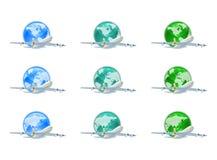 Globos da terra com planos Foto de Stock