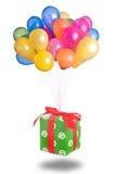 Globos del color con el regalo aislado Imagen de archivo
