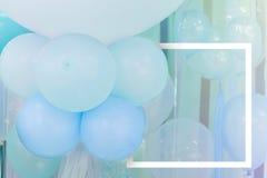Globos del color en colores pastel con el marco del Libro Blanco Foto de archivo libre de regalías
