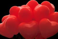 Globos en forma de corazón rojos Fotos de archivo libres de regalías