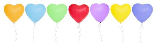 Globos en forma de corazón coloridos en fila Fotos de archivo