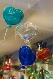 Globos en la forma del vidrio de Murano de los corazones Foto de archivo