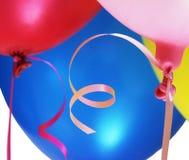 Globos llenados helio del partido Fotografía de archivo