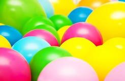 Globos multicolores del partido brillante Imagen de archivo