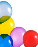 Globos multicolores en el fondo blanco Foto de archivo libre de regalías
