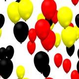 Globos negros amarillos rojos del partido Foto de archivo libre de regalías