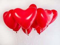 Globos rojos en la forma de un corazón Foto de archivo libre de regalías