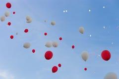 Globos rojos y blancos Imágenes de archivo libres de regalías