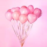 Globos rosados del partido Imágenes de archivo libres de regalías