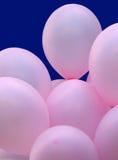 Globos rosados del partido imagenes de archivo