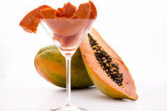 Globose body and tangerine pulp - Papaya. Blazing tangerine fruit pulp of the papaya revealed by a longitudinal cut through this tropical fruit Stock Photography
