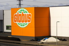 Globus hypermarket company logo in front of store on February 25, 2017 in Prague, Czech republic. PRAGUE, CZECH REPUBLIC - FEBRUARY 25: Globus hypermarket Royalty Free Stock Photography
