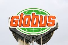 Globus logo on a panel. Marsdorf, Germany - July 1, 2017: Globus logo on a panel. Globus is a German retail chain of hypermarkets, DIY stores and electronics Stock Photo