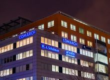 Globus office building. With differenct companies by night on the Roosevelta street on circa January 2018 in Poznan, Poland Royalty Free Stock Photos