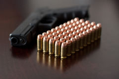 Glock 22 with 40 cal. ammunition Royalty Free Stock Images
