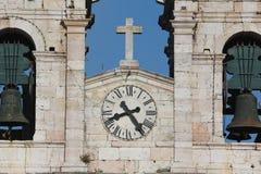 Glocken und Uhr Stockbild
