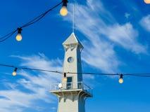 Glockenturm und Glühlampen Stockfotos