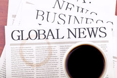 Glodal news and cup of coffee Stock Image